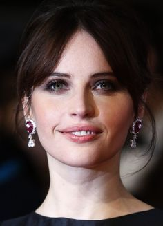 Flawless, radiant skin and a subtle smoky eye. We loved Felicity Jones's paired down beauty look. See more photographs from the BAFTA's 2015 at www.redonline.co.uk.