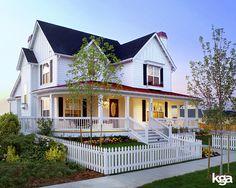 Traditional White Victorian Farmhouse. By KGA Studio Architects, PC.