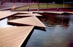 Triangular platforms floating on a pond in the park.