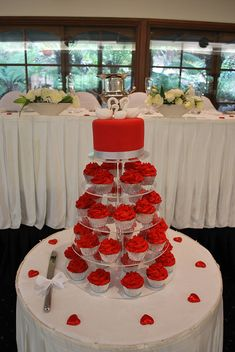 Colorful & fun! The swans on top keep it sweet and simple. A must for a small wedding party.