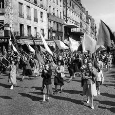 Politics - Manifestation rue du faubourg du Temple 1949 by Robert Doisneau