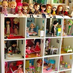 A shelve made into a doll house full of all kinds of rooms...add wall paper to floors and hang small pictures, add the dolls and there you have it, a perfect doll house.