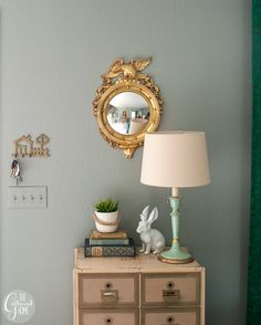 A vintage federal eagle mirror adds a fun detail to this tiny entryway.