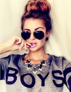 I don't like how it says boys, I wish it said something else but other than that I love everything like her sunglasses her hair, her necklace not as much but it goes with the shirt really well. Everything needs to stay exactly the same except what it days... ~Madeline Edwards~