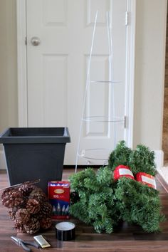 Quick and Easy Evergreen Topiaries: made out of a tomato cage and garland. EASY!