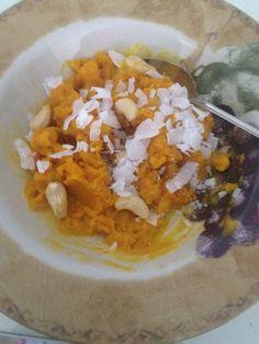 "Kabucha ""oatmeal"" with coconut & a few raw cashews!"