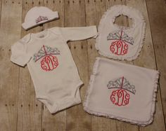 This listing is for your choices of adorable baby items. All items except for the hat include the tiara and a monogram below it.