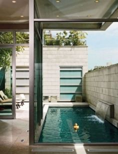 pool . small space. I would Love a pool this size for lap swim or just to cool off.