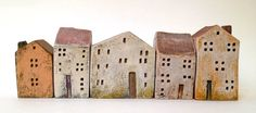 set of 5 ceramic houses in a row , painted with acrylic colors