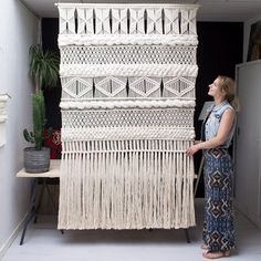 Roomdivider idee Just finished this custom XXL Macrame Wall Screen combined with woven Wool pieces. My biggest design so far, and I'm totally obsessed with it! ❤️ (Link to my Etsy shop in bio) Macrame Curtain, Macrame Cord, How To Macrame, Large Macrame Wall Hanging, Window Hanging, Macrame Design, Big Design, Macrame Projects, Geometric Wall