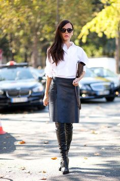 A pair of thigh high leather boots keep your legs warm while adding texture to your look.