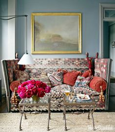 "Alexander Doherty ~ a Knole sofa in antique kilims and heaped it with pillows, creating a modern riff on a Victorian ""cozy corner"" for reading and TV viewing.  #sofamaton"