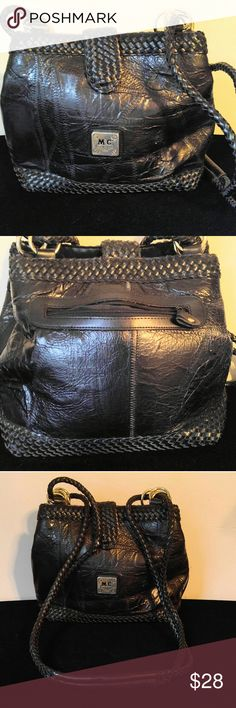 Very Nice Black Leather MC Shoulder Purse MC Marc Chantal Shoulder Purse- This Purse is in great Condition, there is some slight dis-coloration on the back but hardly noticeable! The Strap on this purse is 19 inches long,  The purse measures 12.5 X 9 with a 8.5 inch drop. MC Bags Shoulder Bags