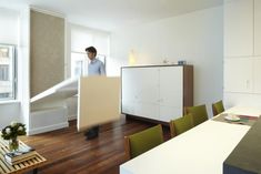 A Hard-Working House in the City : Remodelista. A Hard-Working House in the City : Remodelista. Hide-a-way Table - smart and clean, clever use of space.