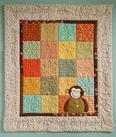 Valle and Fey baby quilt ideas - The stitching on the outer border is too cute.