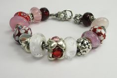 Trollbeads bracelet featuring:   Red Prism, Organic Heart, Double Heart, Valentine, Diamond Bead, Hugging Hearts, Rose Quartz, Heart Ball and more!