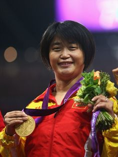 Gold medallist Liu Pingof China poses on the podium during the medal ceremony in the Women's 200m - T35 Final on Day 2 of the London 2012 Paralympic Games at theOlympic Stadium