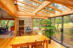 "Abundance of light~ ""The glazing and framing assembly is supported by cedar joists and large beams."" –Houses Made of Wood and Light, by Michele Dunkerley, p. 99"