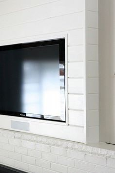 build a planked tv wall to hide the TV and cords (House Tweaking on PopSugar)