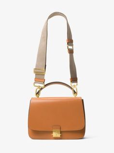 50b530c1636 A utilitarian-inspired strap lends pragmatic character to the Mia shoulder  satchel for an effortless