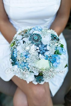 Ruby Blooms is pleased to offer you the Premiere Collection - Spring and Summer wedding bouquet Designed for Something Blue Wedding Theme Bridal Flowers and Special Events! Brooch Bouquet Specificatio