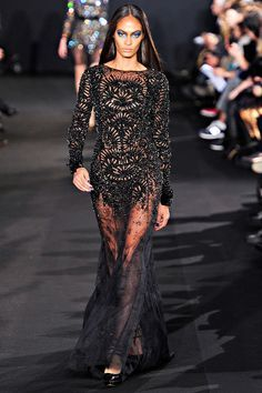Prabal Gurung...a fashion darling of celebrities. Love this simple black gown with the illusion skirt.