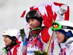 DAY 4:  Gold medalist Alex Bilodeau of Canada celebrates during the flower ceremony for the Freestyle Skiing Men's Moguls Finals
