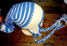 Baby's Winter Stocking Cap - Keep your child warm this winter with the Baby's Winter Stocking Cap crochet pattern. Instead of a typical beanie, this crochet baby hat adds a festive twist onto your child's winter wardrobe.