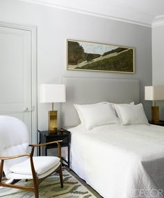 Custom-made nightstands by Benoit Langlade, topped with 1970s lamps, flank the bed in the master bedroom in the Paris home of fashion designer Andrew Gn.  Follow ELLE DECOR on Pinterest for even more inspiration.    - ELLEDecor.com