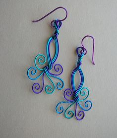 Peacock wire swirl earrings -- Turquoise/Blue/Purple Wire, Spiral Tails, Blue Niobium Ear Wires. $38.00, via Etsy.