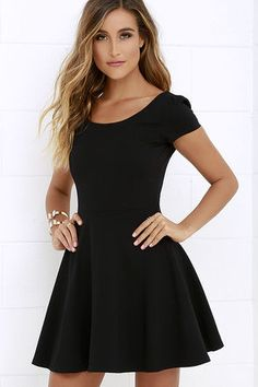 Blue ribbons and trophies may as well come in the mail along with the Winning Look Black Skater Dress! A rounded neckline and scooping back lay between gathered short sleeves amid a knit, princess-seamed bodice. Fitted waist transitions into a classic skater skirt. Hidden back zipper.