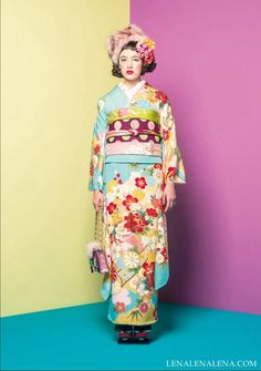 This same obi from several days ago is now paired with blue, red and yellow instead of pink and green—and once again it's punching through the chaos of the traditional design to bring it right up to modern. The kimono itself is utilizing a classic, almost childish sky blue with warm red and lemon yellow flowers—this color set is often seen in 7-5-3 Festival childrens' kimono. But here the fuchsia obi is bringing lime green out of the kimono and into focus as well as ...