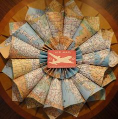 A wreath made of all the maps of places Matt visited in the Marines!