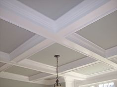 Custom coffered ceiling with a painted base. by Woodmaster Woodworks in Youngsville, NC. FREE in-home estimates locally, within 80 miles. (919) 554-3707 www.woodmasterwoodworks.com