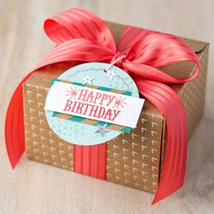 The Shine On designer series paper from 2016 Occasions Mini features fun foiled patterns on one side and bright pops of color on the other that's just perfect for creating custom gift packaging. (the tag on this box was created with the You're So Lovely stamp set)