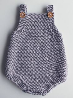 Free Knitting Pattern for Easy Baby Romper - Great beginner pattern. The Eve Romper is a baby playsuit carefully designed to be simple in construction, perfect for a beginner. Knit in garter stitch. Two options for closures.Sizes included: 0-3 months, 3-6 months, 6-12 months & 12-24 months.