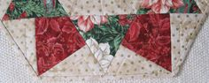 The table topper is machine pieced and machine quilted.  Traditional Christmas colors with gold accents.  This table topper will look great anywhere
