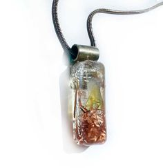 Orgonite to increase love and good health. Healing Crystal and Peridot Pendant necklace. Feminine necklace. Orgone generator