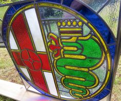 Alfa Romeo in Stained Glass Alfa Romeo Logo, Alfa Romeo Cars, Alfa Bertone, Alfa 4c, Car Logos, Volkswagen Logo, Cars And Motorcycles, Stained Glass, Classic Cars