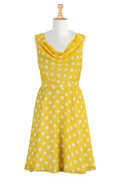 yellow with white polka dots, cowl neck,pleats at the shoulder, imagine a summer event with cocktails or dancing