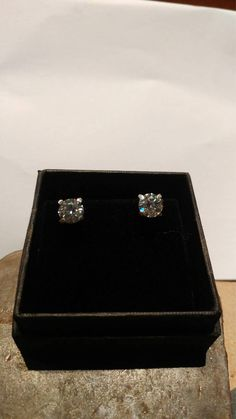 Moissanite and silver studs