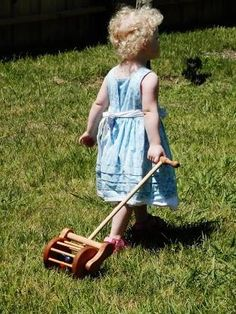 This classic wooden toy lawn mower combines color, sound, and movement. Six…