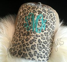 Look cute in a monogrammed Truckerl Hat! They are great for sun, fun, and bad hair days!  This Trucker Style hat will be personalized with your monogram on a leopard, distressed trucker hat. This hat has a mesh back and snap back adjustable closure. Please list the following information in the note to seller section during checkout: 1. Initials (first, last, middle name order)    ***NOTE: Colors viewed online may vary slightly from the actual product colors due to variances in computer…