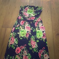 "Navy floral maxi dress Navy strapless maxi dress with neon floral print. 49"" long. Brand new, never worn. Dresses Maxi"