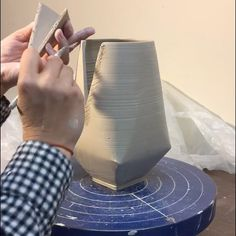 Julia Claire is a ceramic artist working at Odyssey Clayworks in Asheville, NC. In this video, we see Julia showing us how she creates her darted pitcher.
