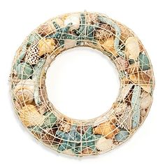 Ocean decor in spray-painted wire wreath cage. Awesome.