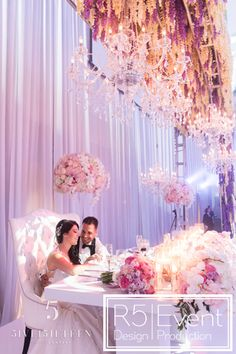 Beautiful Sweetheart Table with our lovely couple! Florals, Chandeliers, runner of candles, hanging wisteria & jumbo flowers by Event Design Reception Rooms, Wedding Receptions, Crystal Candelabra, Floral Chandelier, Event Company, Sweetheart Table, Park Weddings, Wedding Table, Wedding Ideas