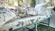 Old day bed. Ekebyholm fabric pattern. Flowerly pillows.