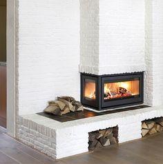 Een inzet haard wordt toegepast om een open haard te renoveren, met een verbetering van het rendement: met minder hout, meer warmte.