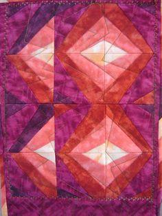 batic fabric purples, reds end pinks diseño tectil